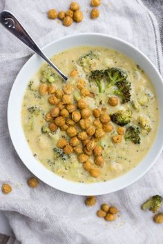 Vegan Roasted Broccoli & Cheese Soup: a vegan take on a classic! Healthy ingredients like nutritional yeast, roasted broccoli, roasted garlic, and onion make up this easy soup!