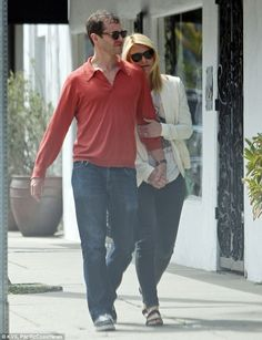 Six years and counting: Claire Danes cuddled up to husband Hugh Dancy on a loved up outing...
