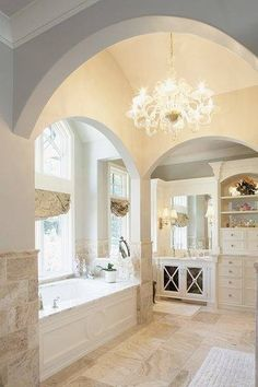 Custom cabinetry is a great way to make your bathroom look truly one of a kind! The built-ins add storage and the crown molding makes the room look complete. Lets not forget to mention the gorgeous undermount tub and chandelier-adds a bit of class and glam to the space.