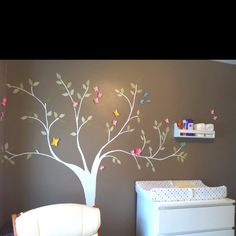 Hand-painted tree girlied up with paper butterflies