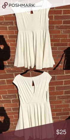 Torrid Cream Dress Very cute and great for spring and summer. Comes from a smoke free and pet free home. Moving soon so I need sell as quickly as possible. Accepting all reasonable offers but please use the offer button. torrid Dresses