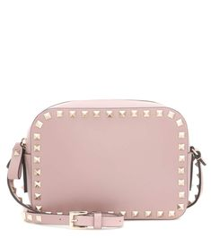 VALENTINO - Rockstud leather crossbody bag - Downsize your tote to this practical shoulder bag from Valentino. Taupe-hued leather, finished with the label's iconic Rockstud hardware, makes for a modern and edgy fusion. Wear it over the shoulder or across your body next to bright colours and monochrome ensembles alike. - @ www.mytheresa.com