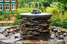 Adding Charm and Relaxation to a Backyard with a DIY Pond and Fountain