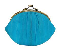 Becksondergaard Turquoise Granny Purse : This beautiful granny purse from danish brand Becksondergaard is simply gorgeous. Made from supper soft Eel skin and featuring a metal clasp to open and close with. The inside features a smaller inner compartment to store any necessary items.