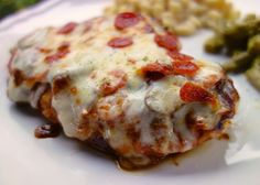 Pizza Smothered Chicken - italian marinated chicken topped with pizza sauce, pizza toppings and mozzarella