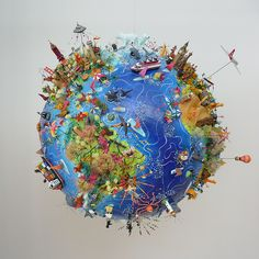 Sara Drake - Globe Map 3D illustration made from papier mache, balsa and mixed media