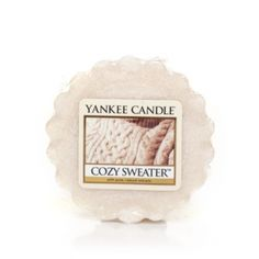 Cozy Sweater™ Cozy Sweater Yankee Candle Company Tarts® Wax Melts - There's nothing quite as comfy as curling up in an oversized sweater, soft as a flower petal, on a cool fall day. This fragrance's warm touches of musk and patchouli will have you kicking back and relaxing in no time at all. You'll find a nice floralcy to the scent, accompanied by a warm base . . . almost amber-like. The neutral color of the wax was inspired by the darker wool fibers in a fisherman's sweater.