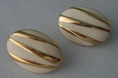 """White Enamel with Gold Stripes Oval Pierced Earrings. White enamel oval shaped pierced earrings with gold tone stripes and hollowed out back. 1"""" tall by 0.5"""" wide."""