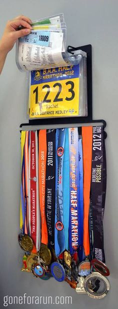 Display your collection of race bibs and running medals as a work of art with the BibFOLIO+™ race bib and medal display from Gone For a Run. This running display holds up to 24 race medals and 100 race bibs. Running Workouts, Running Tips, Trail Running, Running Humor, Running Medals, Running Sports, Race Bibs, Half Marathon Training, Triathlon Training