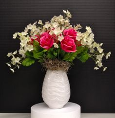 Spring Season 2014 Table Top: Faux Pink Roses and White Cream Cups, nested on natural moss on white leaf ceramic vase. Design and Arrangement by http://nfmdesign.synthasite.com/