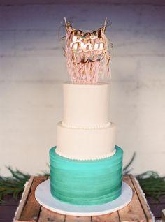 teal wedding cake - photo by Gaby J Photography http://ruffledblog.com/las-vegas-wedding-with-bohemian-details #weddingcake #cakes #caketopper