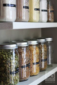 Pantry shelves with canning jars and labels from 86lemons.com.