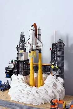 As a younger child, I loved building Lego sets. My favorite type of Lego sets were like this one that represents a city setting. Lego Design, Lego Space Shuttle, Lego Machines, Lego City Sets, Lego City Space, Lego Space Sets, Lego Sculptures, Lego Boards, Amazing Lego Creations