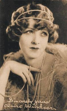 ARCADE CARD - EXHIBIT SUPPLY COMPANY - MOVIE STAR - CLAIRE WINDSOR - ALMOST FULL FACE - EYES UP - FINGERING PEARLS - 1920s
