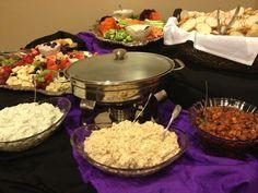 Crostini buffet with hot spinach and artichoke dip, bruschetta salsa, spicey cajun crab, and garlic herb spreads catered by www.SamandRoscosRestaurant.com