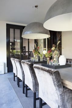 Gray and silvery dining table! Love the two large silver metal pendant lights over the table! Dining Room Walls, Dining Room Furniture, Furniture Decor, Pendant Lighting Over Dining Table, Luxury Dining Room, Dining Table Design, Dining Room Inspiration, Interior Design, Lantern Chandelier