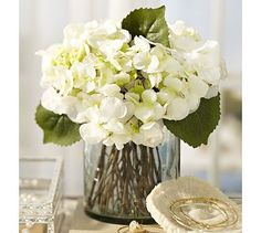 looks very elegant - would look nice on the long dining table, or in a vase like this in the family room or small kitchenette table. Faux Hydrangea Arrangement in Clear Glass Vase #potterybarn