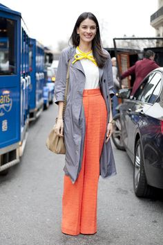 Très Chic! The Best Street Style at Paris Fashion Week: A bow-tied necklace married perfectly with the tangerine color of her trousers — equal parts ladylike and a little playful.