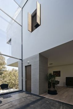 30ft tall glass wall in the landing at Casa U in a Mexico City suburb