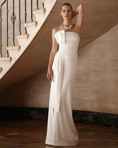 This elegant White House Black Market gown ($348) has the sculptural details of a much more expensive gown.