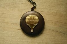 Long Hot Air Balloon Locket Necklace, Vintage Pendant, Large Air Balloon Locket by FreshyFig on Etsy https://www.etsy.com/listing/84327966/long-hot-air-balloon-locket-necklace