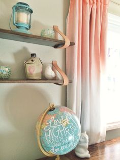 SO many fab nursery DIYs: Wood + Leather Suspended Shelf, Hand-dyed Curtains + the Vintage Globe Hand-Painted with a Quote! #DIY #nursery