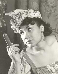 WOMAN WITH CIGAR | 1940′S Katherine Dunham in an undated photograph as Woman with a Cigar from Tropics. Alfredo Valenti, photographer. Credit: Special Collections Research Center, Morris Library,...