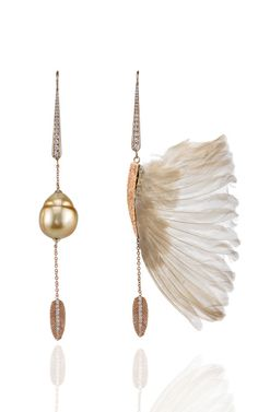 These Daniela Villegas assymetrical earrings feature a feather motif with 18k pink gold set white diamonds descending to a champagne barroque pearl on one side and a finch wing on the other, and a dangling pink gold feather set with fine diamonds at the spine.   For pierced ears  18K Rose Gold .58 White Diamonds Champagne Barroque Pearl Made in Los Angeles