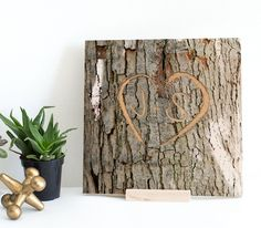 Personalized Memory Tree Bark Image Keepsake - Engraved Heart Shape with Custom Initials onto Real Wood Canvas | Initial Gifts | Couple's Gift | Wedding Gifts | 5th Anniversary Gifts Valentine Gifts. ***Product Launch Special*** Engrave your custom text or initials on a real piece of wood canvas! The wood canvas is imprinted with a tree bark, which includes the engraving of your initials in a heart shaped symbol. The engraving is carved onto real wood to create a unique 3D effect as if it...