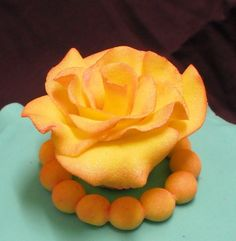 Fondant yellow rose with lustre dust atop a last minute cake for a friend's afternoon tea. I rushed to finish this, hence, side lines are a  bit wonky. TFL