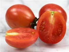 """Tomato Umberto aka """"King Humbert"""" - Heirloom- Origin Italy These are an old-Italian heirloom, was listed by the renowned French seedhouse Vilmorin-Andrieux in 1885. This fruit was named after King Umberto I, King of Italy in the late 19th century. - Growth Indeterminate- Variety small pear shaped- These fruit are pink-red, meaty with a nice mix of sweet and tart. Use these fruit for paste, sauce or for drying. http://www.rareseeds.com"""