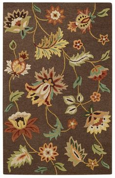 The Floral Garden style is a new wool, transitional rug design from Capel Rugs. Floral Garden rugs have a hand tufted construction. The cocoa colorway is a beautiful addition to our assortment of brown and beige area rugs