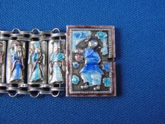 Clasp detail of great old enameled silver Daoist Immortals bracelet.