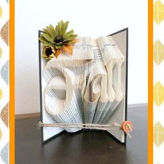 Book art with the word Fall is a great addition to any decor. #bookfolding #bookart #falldecor