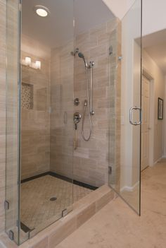 The rectangle tile is interesting.  Would move the niche to the opposite side of the shower head.