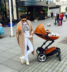 Stylish momma and actress Agne Jagelaviciute and little one are seen here with their mima kobi camel in Lithuania!