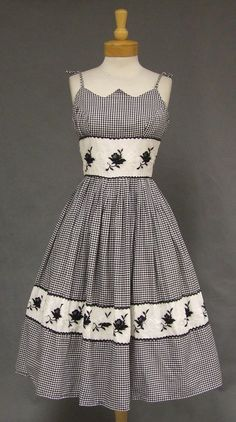 http://www.vintageous.com/terrific-black-white-gingham-1950s-sun-dress-w-embroidered-insets/