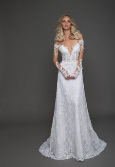 A-line cap sleeve gown with sheer lace bodice and satin skirt.