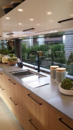 Kitchen cabinetry window splashback