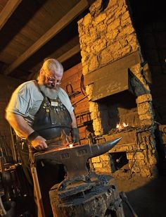 A blacksmith conducts demontrations at the John Deere Historic Site.