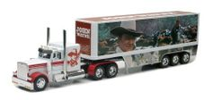 John Wayne Peterbilt Die Cast Semi-Truck Tractor and Trailer Hauler Set by New Ray Toys, Inc.. $26.99. 1:32 scale.. About 22.5 inches long.. The Duke rounds 'em up as pictured on the side of this tractor/trailer! Peterbilt hauler is crafted in die cast metal with plastic trim that gleams like chrome. Detailed lights, mirrors, exhaust stacks, bumper, gas tanks, tire rims, grill, diamond plate surfaces, and more. Features include moving tires and a hinged rear door/loadin...