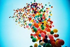 color your neighbourhood. blow 11 balloons in different colors. let them fly from the roof of your building. film the flight of colors and the faces of people.