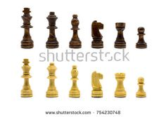 Wooden chess set lined up in rows isolated