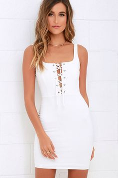 If you've been loving the lace-up look, we know the Quite Curious Ivory Lace-Up Dress will satisfy your craving! From tank straps, medium-weight stretch knit falls to a princess-seamed bodice, and sexy lace-up front (with silver grommets). Bodycon fit and tube skirt complete this sexy ensemble. Hidden back zipper.