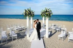 i like how the chairs are circling the bride and groom | Beach wedding in the sand | The Omphoy Ocean Resort and Spa
