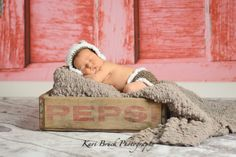 Newborn baby studio session. Newborn inspiration for baby pictures with hand made hats and a vintage crate. Picture ideas for your newborn baby. Image by Kari Bruck Photography