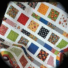white filmstrip quilt with Mary Engelbreit fabricFlowers in the Sunshine Quilt Pattern 2 charm packsMary Engelbreit Baby Quilt Toddler Quilt MADE by cachecreekquiltsMary Engelbreit Attitude by Cache Creek Quilts? Charm Pack Quilt Patterns, Layer Cake Quilt Patterns, Layer Cake Quilts, Charm Pack Quilts, Scrap Quilt Patterns, Charm Quilt, Block Patterns, Patch Quilt, Quilt Blocks
