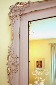 Old gold mirror made over in Antoinette Chalk Paint® Decorative Paint by Annie Sloan, wet distressed to show some gold underneath.  Blog post shares tips for painting a frame without removing the mirror.