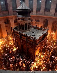 Holy Week and Easter _ The Church of the Holy Sepulcher during the Christian Orthodox Holy Fire ceremony in Jerusalem's Old City
