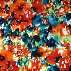 Abstract Watercolor Garden Cotton Jersey Blend Knit Fabric - A gorgeous designer overstock score! Abstract watercolor paint daubs look floral garden in reds, orange, teal blue, and green on a white cotton jersey rayon blend knit.  Fabric has a smooth and soft hand, nice stretch, fluid drape, and is light to mid weight.  Beautiful fabric that is suitable for many different uses!  ::  $6.25